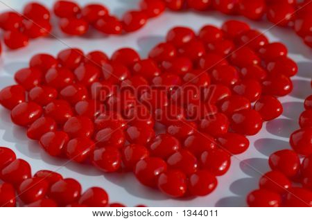 Valentine Red Candies On A Flat Background