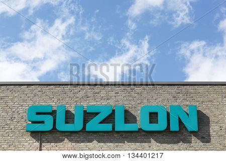 Aarhus, Denmark - June11, 2016: Suzlon logo on a wall. Suzlon Energy Limited, is a wind turbine supplier based in Pune, India. Formerly ranked as the world's fifth largest supplier