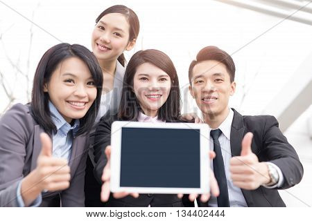 Business people team show empty computer screen with copy space shot in Hong Kong asian woman and man