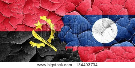 Angola flag with Laos flag on a grunge cracked wall