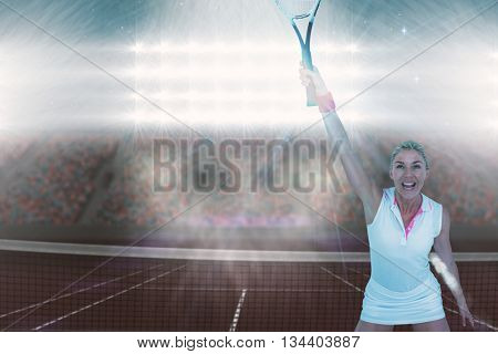 Athlete celebrating after victory against digitally generated image of supporters in tribune