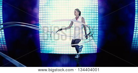Athlete playing tennis with a racket against background of blue squares