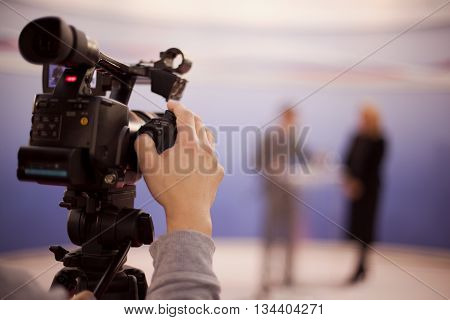 Television broadcasting. Filming an event with a video camera.