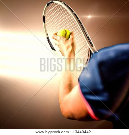 Tennis player holding a racquet ready to serve against spotlights