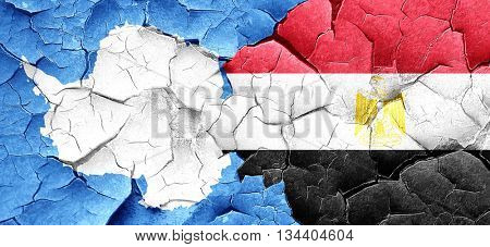antarctica flag with egypt flag on a grunge cracked wall