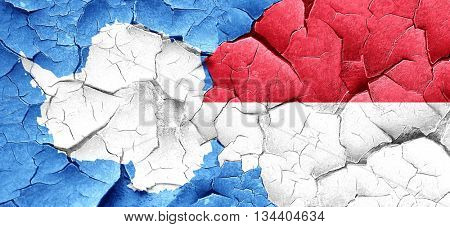 antarctica flag with Indonesia flag on a grunge cracked wall