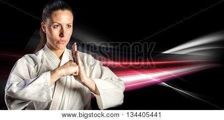 Female fighter performing hand salute against black background