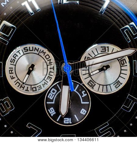 wristwatch closeup with seconds, minutes and hours hands