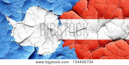 antarctica flag with Austria flag on a grunge cracked wall