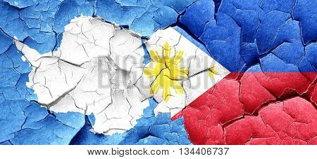 antarctica flag with Philippines flag on a grunge cracked wall