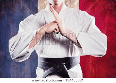 Fighter performing hand salute against france flag in grunge effect