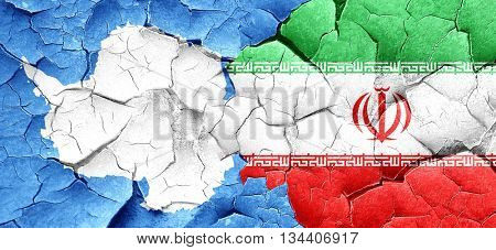 antarctica flag with Iran flag on a grunge cracked wall