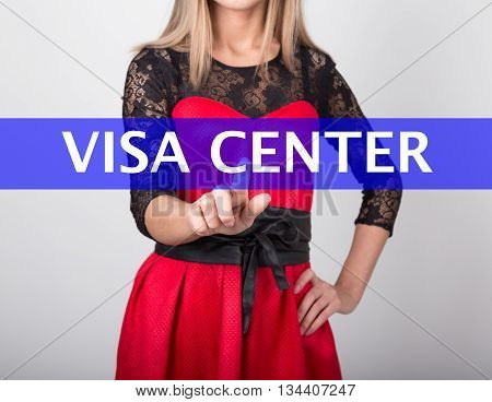 technology, internet and networking concept. beautiful woman in a red dress with lace sleeves. woman presses visa center button on virtual screens.