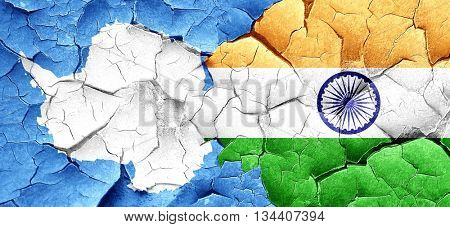 antarctica flag with India flag on a grunge cracked wall