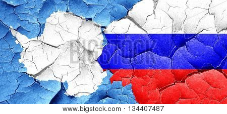 antarctica flag with Russia flag on a grunge cracked wall