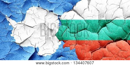 antarctica flag with Bulgaria flag on a grunge cracked wall