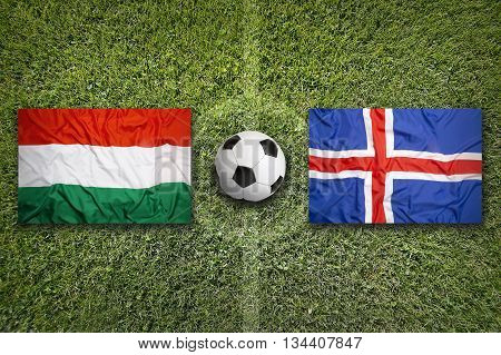 Hungary Vs. Iceland Flags On Soccer Field