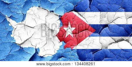 antarctica flag with cuba flag on a grunge cracked wall