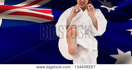 Fighter performing karate stance against australia flag waving