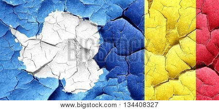 antarctica flag with Romania flag on a grunge cracked wall