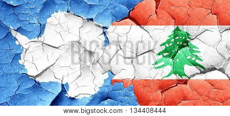 antarctica flag with Lebanon flag on a grunge cracked wall