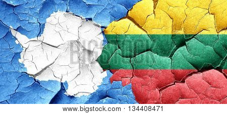 antarctica flag with Lithuania flag on a grunge cracked wall