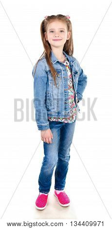 Adorable smiling little girl in jeans isolated on a white