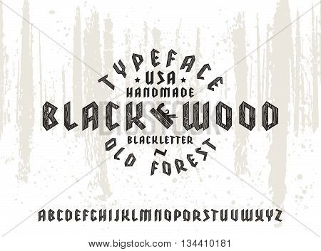 Sanserif font in black letter style decorated wood texture. Gothic typeface on forest texture background