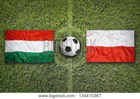Hungary Vs. Poland Flags On Soccer Field