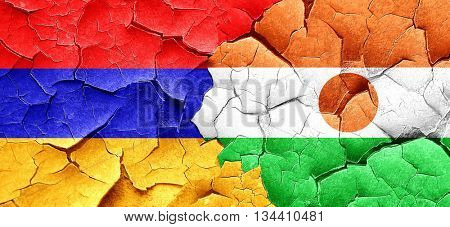 Armenia flag with Niger flag on a grunge cracked wall