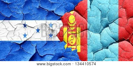 Honduras flag with Mongolia flag on a grunge cracked wall