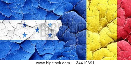 Honduras flag with Romania flag on a grunge cracked wall