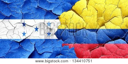 Honduras flag with Colombia flag on a grunge cracked wall