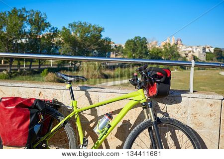 Ribarroja del turial village from old stone bridge with bicycle at valencia spain
