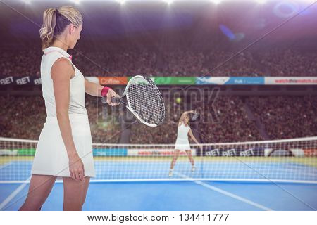 Athlete playing tennis with a racket against composite image of tennis woman playing on court