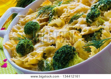 Pasta and broccoli casserole baked with cheese and cream sauce.