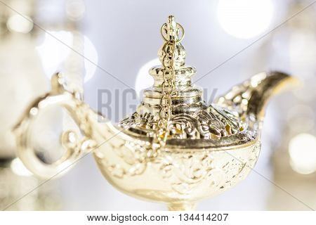 Aladdin's magic lamp with out of focus light as background