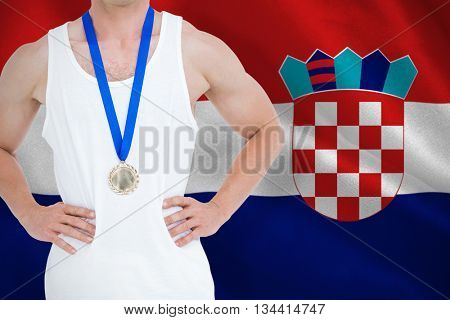Close-up of athlete with olympic medal against digitally generated croatia national flag