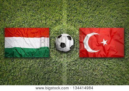 Hungary Vs. Turkey Flags On Soccer Field