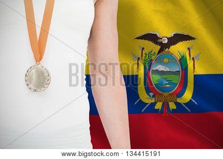 Female athlete wearing a medal against digitally generated ecuador national flag