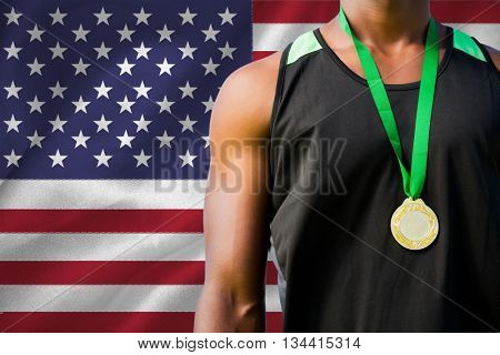 Portrait of sportsman chest with a medal against digitally generated american national flag