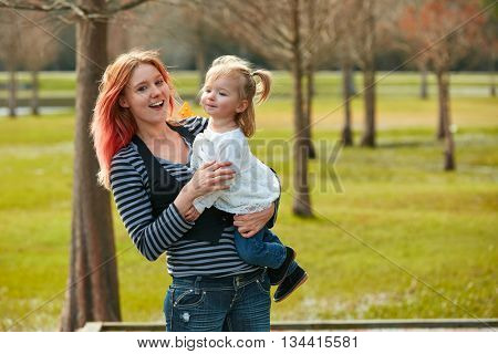 Mother and daughter playing together in the park