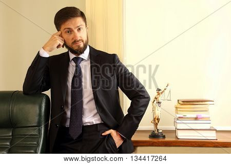 the a successful lawyer in his office