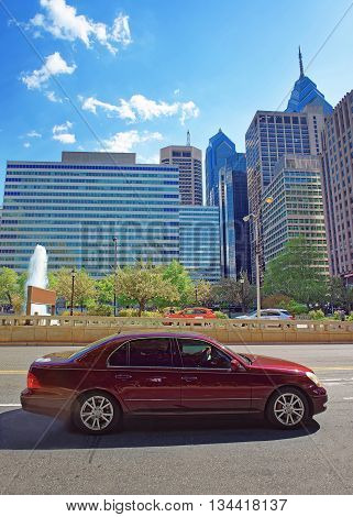 Car On Jfk Boulevard And Penn Center With Skyscrapers