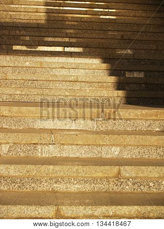 Wide stone stairway with pattern formed by shadows and highlights