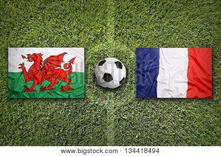 Wales Vs. France Flags On Soccer Field