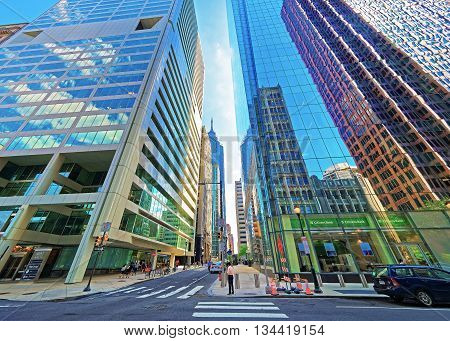Street View With Skyscrapers Reflected In Glass In Philadelphia