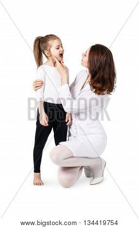 Doctor examining throat of little girl isolated on white
