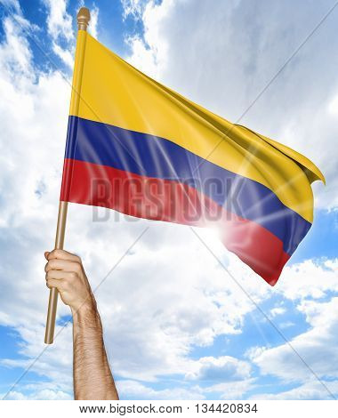 Person's hand holding the Colombian national flag and waving it in the sky, part 3D rendering