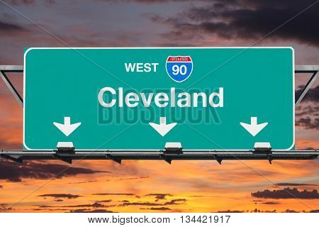 Cleveland Interstate 90 west highway sign with sunrise sky.